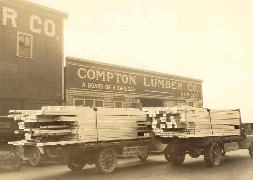 Two vintage Compton Lumber trucks